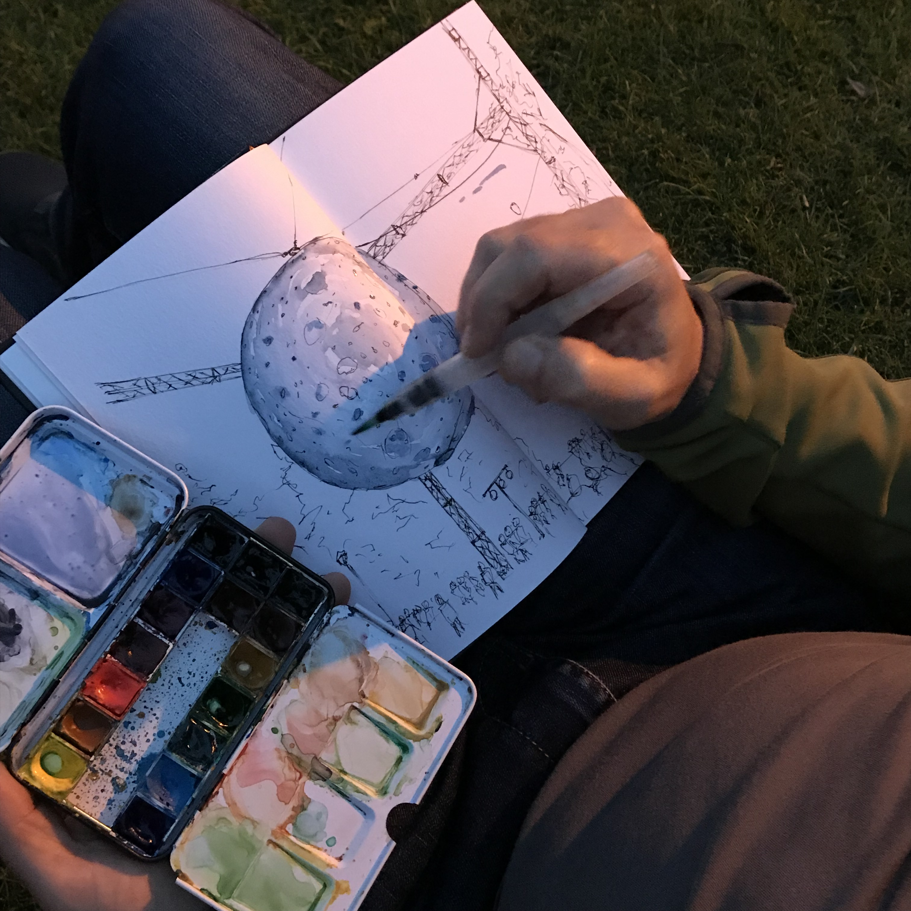 Trent Bauman adds watercolour to his pen and ink sketch of the Moon Museum.